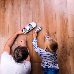 Father and kid playing with toycar   Pilot Floor Covering