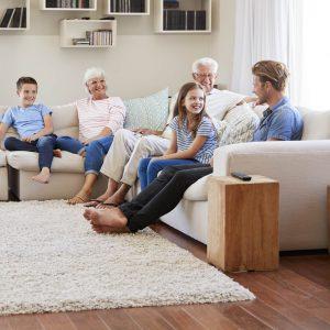 Family enjoying in living room   Pilot Floor Covering